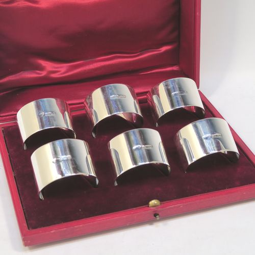 A very handsome Antique Sterling Silver set of six napkin rings, having plain round bodies with straight sides, all in their original maroon satin and velvet-lined presentation box. Made by Goldsmiths and Silversmiths of London in 1912. The dimensions of these fine hand-made antique silver napkin rings are diameter 4.5 cms (1.75 inches), height 3 cms (1.25 inches), and they weigh a total of approx. 285g (9.2 troy ounces).