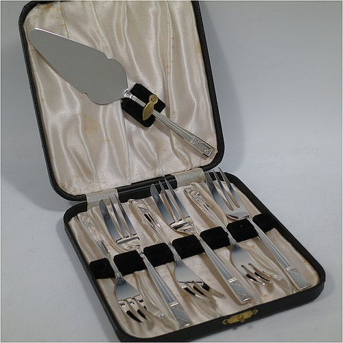 A very pretty and unusual Sterling Silver set of six pastry forks and cake server, having single-struck Art Deco style handles, and three tined forks, all in their original cream satin and black velvet-lined presentation box, with an extra cake server in the lid. Made by Emile Viner of Sheffield in 1990. The dimensions of these fine hand-made silver pastry forks are length 14 cms (5.5 inches), and they weigh a total of 174g (5.6 troy ounces).