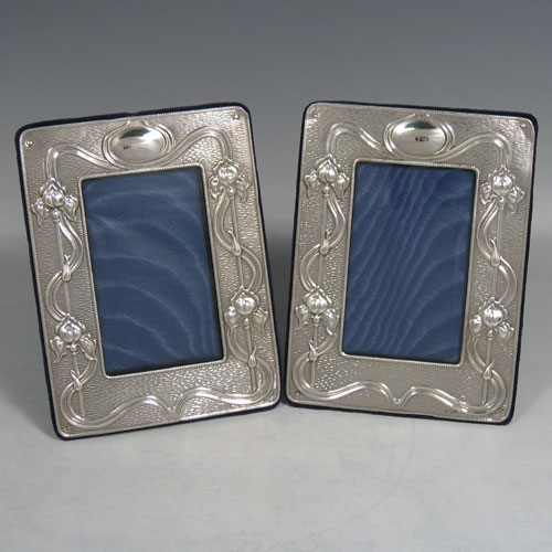 Edwardian sterling silver pair of Art Nouveau photo frames made by A. & J. Zimmerman of Birmingham in 1910. Dim 8 x 5 cms.