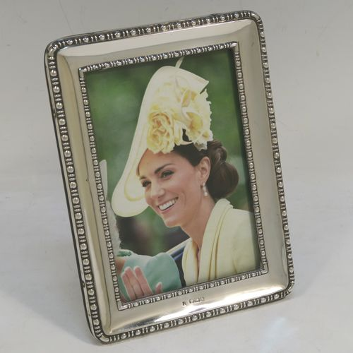 A very pretty Antique Sterling Silver portrait photograph frame, having a hand-made rectangular body with pinned edges, a double pearl and dart border, and an original wood-backed easel frame. Made by James and Walter Deakin of Sheffield 1915. The internal dimensions of this fine hand-made antique silver photo frame are height 13 cms (5.25 inches), and width 8.5 cms (3.3 inches).