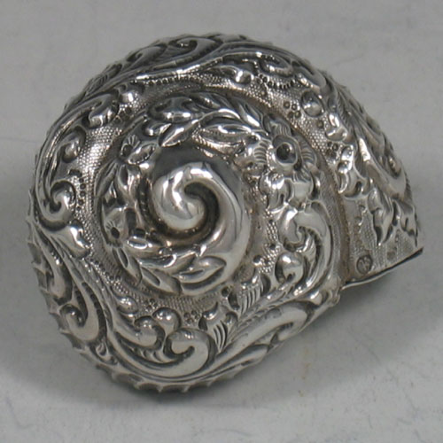 Antique Victorian sterling silver hand-chased snail pillbox made in Sheffield, 1898. Length 5 cms.
