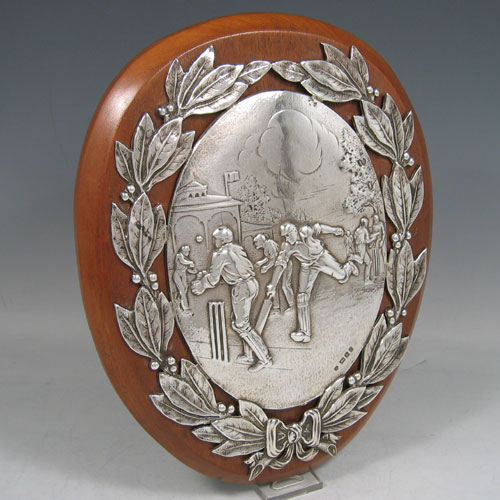 Sterling silver Cricket trophy plaque made in London, 1920. Height 23 cms, width 18.5 cms.
