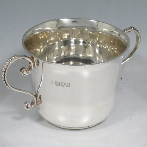 An Antique Victorian Sterling Silver porringer, having a plain round baluster body, two scroll side handles with beaded decoration, and sitting on a flat base. Made by Francis Higgins of London in 1897. The dimensions of this fine hand-made antique silver porringer are height 7.5 cms (3 inches), spread across arms 14 cms (5.5 inches), and it weighs approx. 163g (5.3 troy ounces).