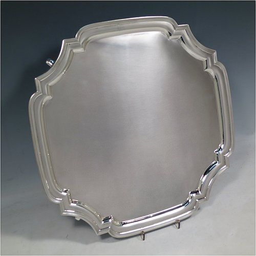 A Sterling Silver salver, having a square cut-corner body, with a plain burnished ground, an applied cut-corner border, and sitting on four cast hoof feet. Made by Robert Pringle of London in 1935. The dimensions of this fine hand-made silver salver are 34 cms (13.5 inches) square, and it weighs approx. 1,116g (36 troy ounces).