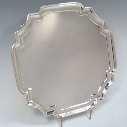 A very handsome Sterling Silver salver, having a square cut-corner body, with a plain burnished ground, an applied cut-corner border, and sitting on four cast scroll feet. Made by Goldsmiths and Silversmiths of London in 1928. The dimensions of this fine hand-made silver salver are 30.5 cms (12 inches) square, and it weighs approx. 958g (31 troy ounces).
