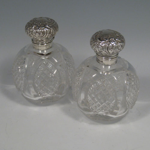 Sterling silver and hand-cut crystal pair of table scent bottles made by H. Miller of Birmingham in 1908. Height 11.5 cms (4.5