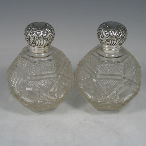 Antique Victorian sterling silver and hand-cut crystal pair of scent bottles, made by Edward Moses Levetus of Birmingham in 1892. Height 12 cms.