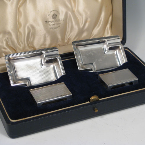 Sterling silver Art Deco smoking accessory set consisting of two ash-trays and two match-box covers, in original satin & velvet-lined presentation box. Made by Mappin & Webb of Birmingham in 1936. Length of ash-trays 7.5 cms (3