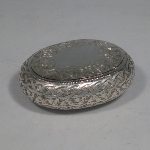 Antique Edwardian sterling silver squeeze-action tobacco box. Having an oval hand-engraved body and gold-gilt interior. Hallmarked for Birmingham in 1908. Length 8 cms (3 inches), width 6 cms (2.25 inches). Weight approx. 50g (1.6 troy ounces).