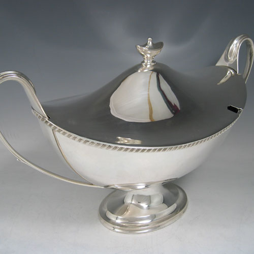 Edwardian sterling silver neoclassical boat-shaped soup tureen made by the Goldsmiths & Silversmiths of London in 1907. Height 22 cms, width (across handles) 37 cms.
