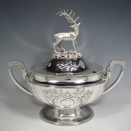 Antique Victorian silver plated soup tureen, having a pull-off lid with a cast model of a stag, with hand-chased floral decoration, applied bead-edged borders, two scroll side-handles, and all sitting on a pedestal foot. Made in ca. 1870. The dimensions of this fine hand-made silver-plated soup tureen and cover are height 33 cms (13 inches), length including handles 37 cms (14.5 inches), and width 20 cms (8 inches).