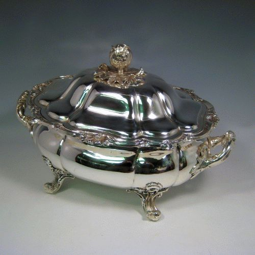 Antique Victorian silver plated soup tureen with pull-off lid, melon-style fluted body, cast floral and shell borders, and cast floral handles and feet. Made by G.R. Collis & Co., in ca. 1870. Height 26 cms (10.25 inches), length including handles 41 cms (16 inches), width 27 cms (10.5 inches).