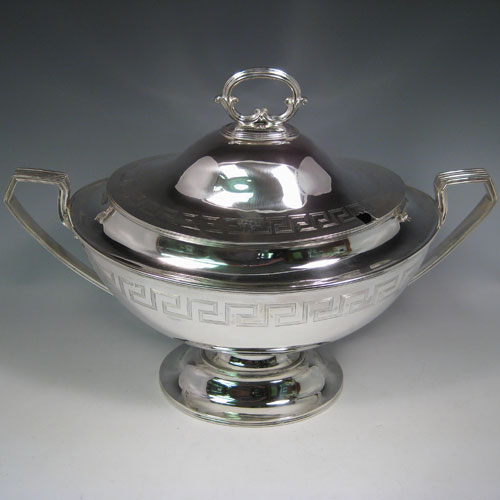 Antique Victorian sterling silver oval neoclassical style soup tureen and cover, with Greek-key style hand-engraving and reeded handles. Made by Walker & Hall of Sheffield in 1901. Height 33 cms (13 inches), length 46 cms (18 inches), width 23.5 cms (9.25 inches). Total weight approx. 91 troy ounces (2,281g).
