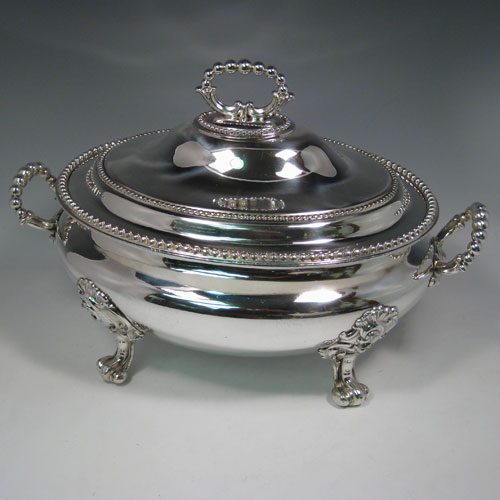 Antique Victorian silver plated oval soup tureen and cover with bead edges and handles, sitting on floral scroll feet. Made in ca. 1880. Height 25 cms (10 inches), length 38 cms (15 inches), width 25 cms (10 inches).