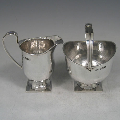 Sterling silver Arts & Crafts hand-hammered sugar and creamer made by Robert Prout of London in 1945. Height 13 cms, width 9 cms (of sugar).