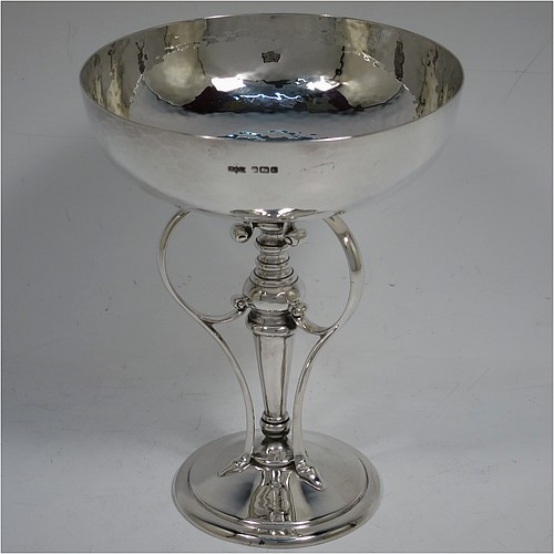 A very pretty Art Nouveau style Antique Edwardian Sterling Silver tazza dish or bowl, having a plain round bowl body with hand-hammered decoration, sitting on a pedestal foot with three scrolled side-handles. Made by James Dixon and Sons of Sheffield in 1905. The dimensions of this fine hand-made antique silver tazza bowl or dish are height 15 cms (6 inches), diameter of bowl 12 cms (4.75 inches), and it weighs approx. 272g (8.8 troy ounces).