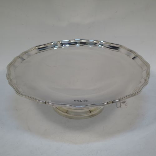 A handsome and heavy Sterling Silver tazza dish, having a round body with an applied and shaped reeded border, and sitting on a round stepped pedestal foot. Made by Z. Barraclough and Sons Ltd., of Sheffield in 1932. The dimensions of this fine hand-made silver tazza dish are height 8 cms (3 inches), diameter 25.5 cms (10 inches), and it weighs approx. 780g (25 troy ounces).