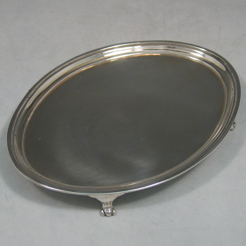 Antique Georgian sterling silver plain oval teapot stand made by Soloman Hougham of London in 1793. Length 15 cms, width 11 cms.