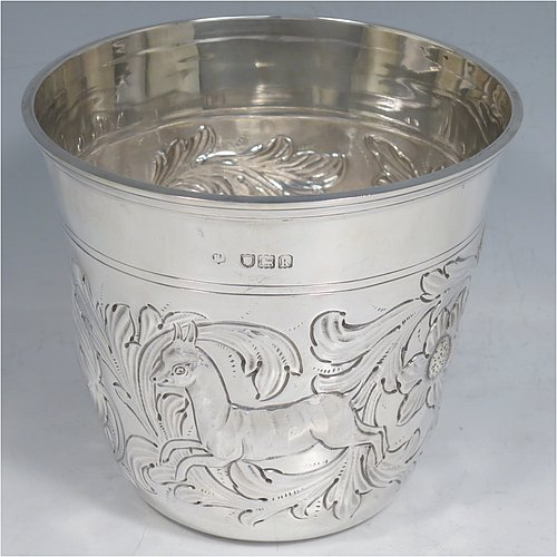 An Antique Edwardian Sterling Silver single fern or flower pot vase, having a round body with tapering sides, with hand-chased floral and animal decoration, and sitting on a flat base. Made in London in 1905. The dimensions of this fine hand-made silver fern pot vase are height 11 cms (4.25 inches), diameter at top 12.5 cms (5 inches), and it weighs approx. 250g (8 troy ounces). Please note that this pot is not loaded.