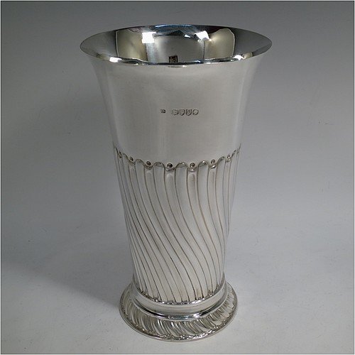 An Antique Victorian Sterling Silver large table flower vase, having a round body with straight tapering sides, with hand-chased half swirl-fluted decoration, and sitting on a fluted pedestal foot. Made by Frederick Brasted of London in 1887. The dimensions of this fine hand-made antique silver vase are height 23.5 cms (9.25 inches), diameter at top 14 cms (5.5 inches), and it weighs approx. 570g (18.4 troy ounces). Please note that this vase is not loaded.
