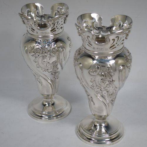 A very pretty pair of Antique Victorian Sterling Silver Art Nouveau style vases, having hand-chased floral and scroll decoration, with hand-pierced upper necks and applied scroll borders, and all  sitting on round stepped pedestal feet. Made by Walter and Charles Sissons of London in 1900. The dimensions of this fine pair of hand-made antique silver Art Nouveau vases are height 17 cms (6.75 inches), and diameter at top 7 cms (2.75 inches). Please note that these vases are not loaded, and the total weight of silver is 422g (13.6 troy ounces).