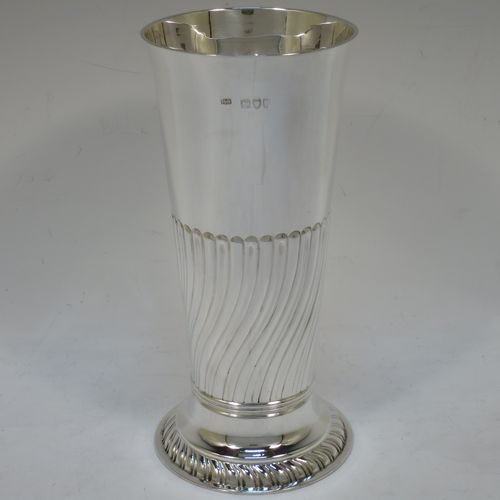 A handsome Antique Victorian Sterling Silver large table flower vase, having a round body with straight tapering sides, with hand-chased half swirl-fluted decoration, and sitting on a fluted pedestal foot. Made by Henry Stratford of London in 1892. The dimensions of this fine hand-made antique silver vase are height 19 cms (7.5 inches), diameter at top 8.5 cms (3.3 inches), and it weighs approx. 261g (8.4 troy ounces). Please note that this vase is not loaded.