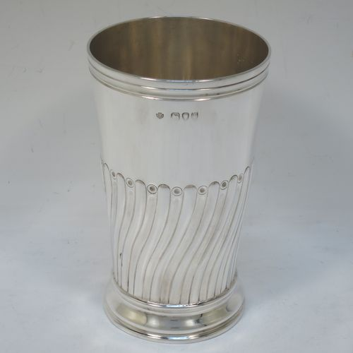 A handsome Antique Victorian Sterling Silver table flower vase, having a round body with straight tapering sides, with hand-chased half swirl-fluted decoration, and sitting on a collet foot. Made by the Barnard Brothers of London in 1894. The dimensions of this fine hand-made antique silver vase are height 14 cms (5.5 inches), diameter at top 8 cms (3 inches), and it weighs approx. 215g (7 troy ounces). Please note that this vase is not loaded.