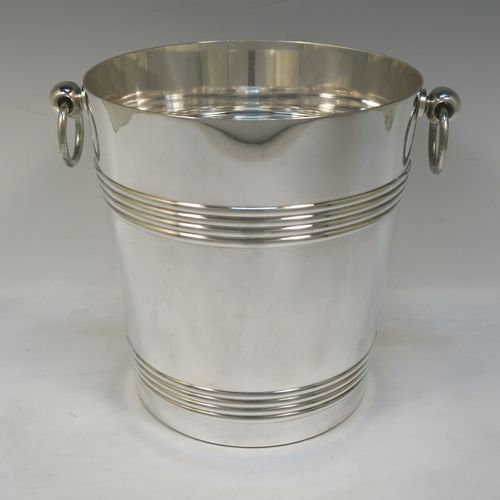 A very handsome Antique French Silver Plated wine bottle cooler, having a plain round body with tapering sides, with two bands of hand-engraved reeded decoration, and two cast ring side-handles, all sitting on a flat base. Made in ca. 1930 by the French silversmith Christophle. The dimensions of this fine hand-made antique silver-plated wine cooler are height 20 cms (8 inches), and diameter at lip 19 cms (7.5 inches). Please note that this will easily hold a magnum size bottle.