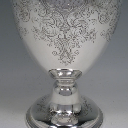 Antique Victorian sterling silver wine ewer with hand-engraved floral decoration, hinged lid with cast flower finial, insulated scroll handle, and sitting on a pedestal foot. Made by the Barnard Brothers of London in 1845. Height 35 cms (13.75 inches), length 16 cms (6.25 inches). Weight approx. 905g (29.2 troy ounces).